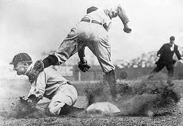 cropped version of iconic photo showing ty cobb stealing third base