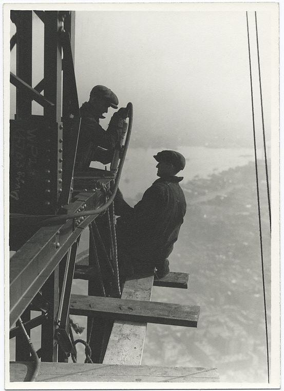 two workers riveting a corner beam of empire state building