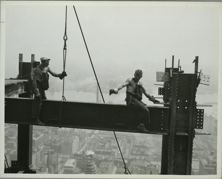 sitting on steel beam high up no safety harness building empire state building