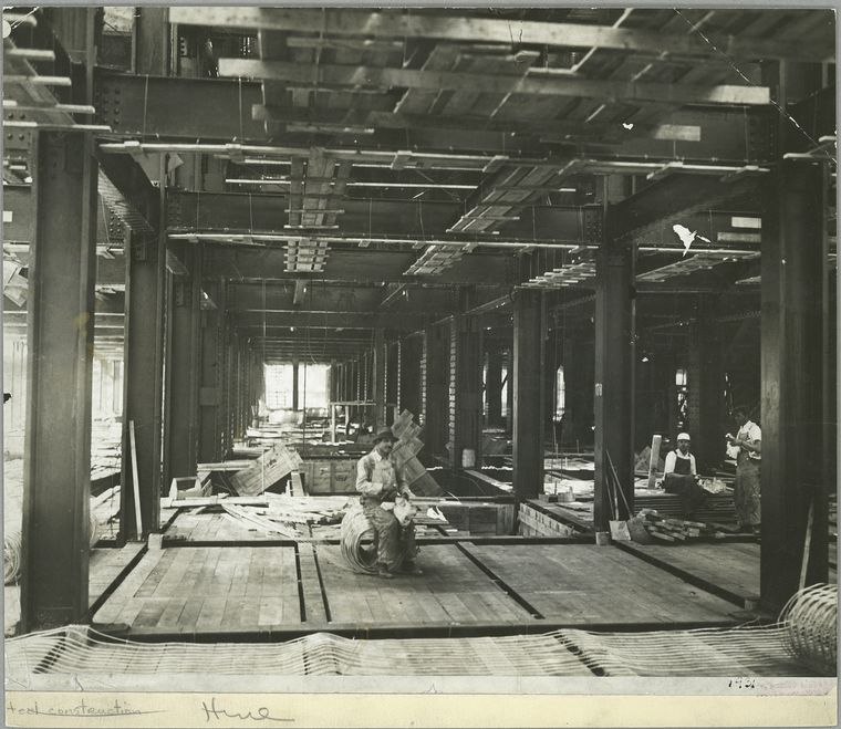 workers having lunch on one of the floors that have been built