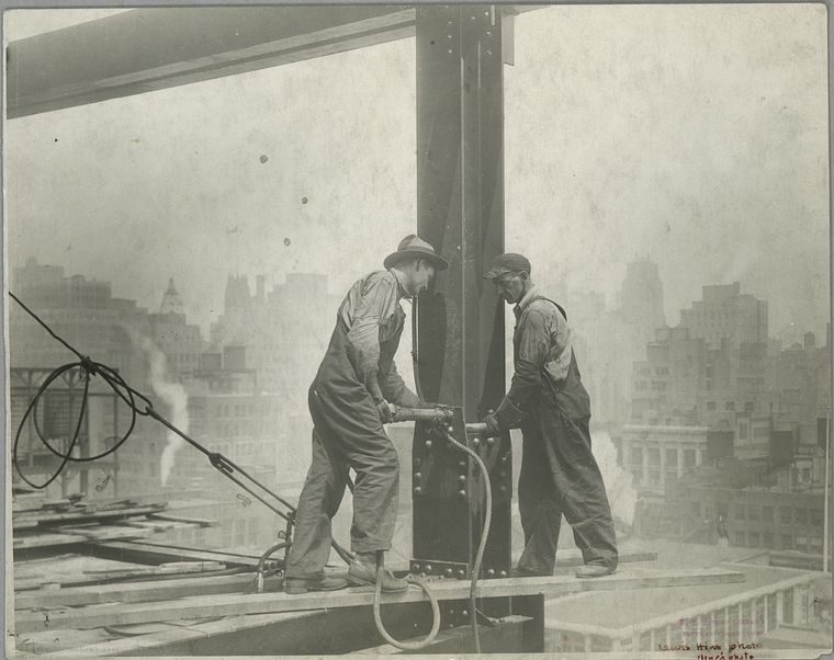 two men standing on plank riveting empire state building 1931 no safety harness