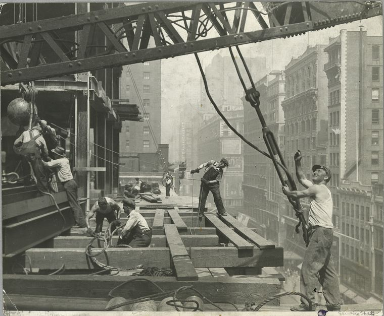 empire state building workers guiding a hoisting cable 1931 many workers visible in photo