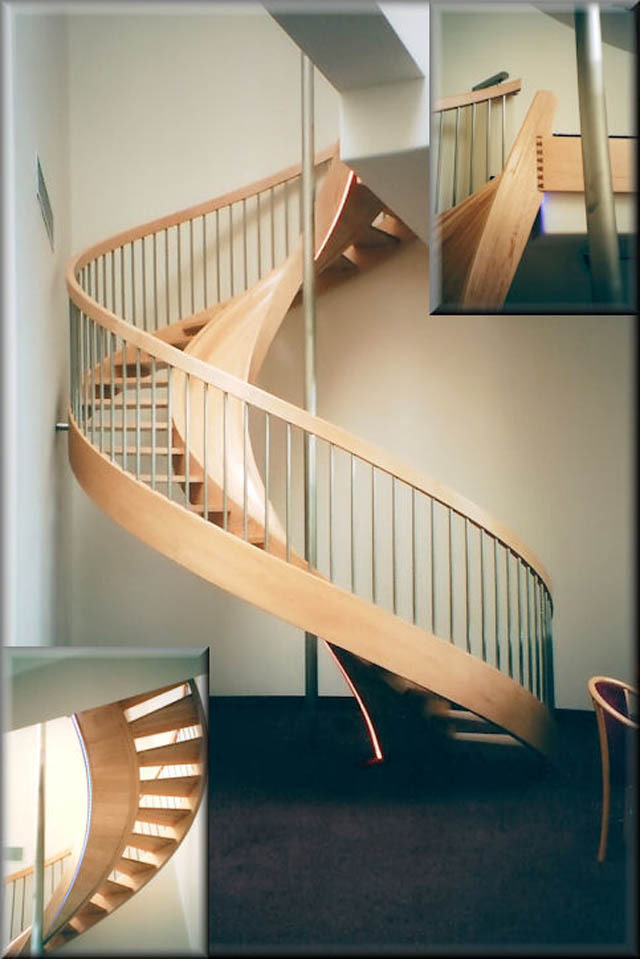 spiral wooden staircase inside a house with a built-in slide