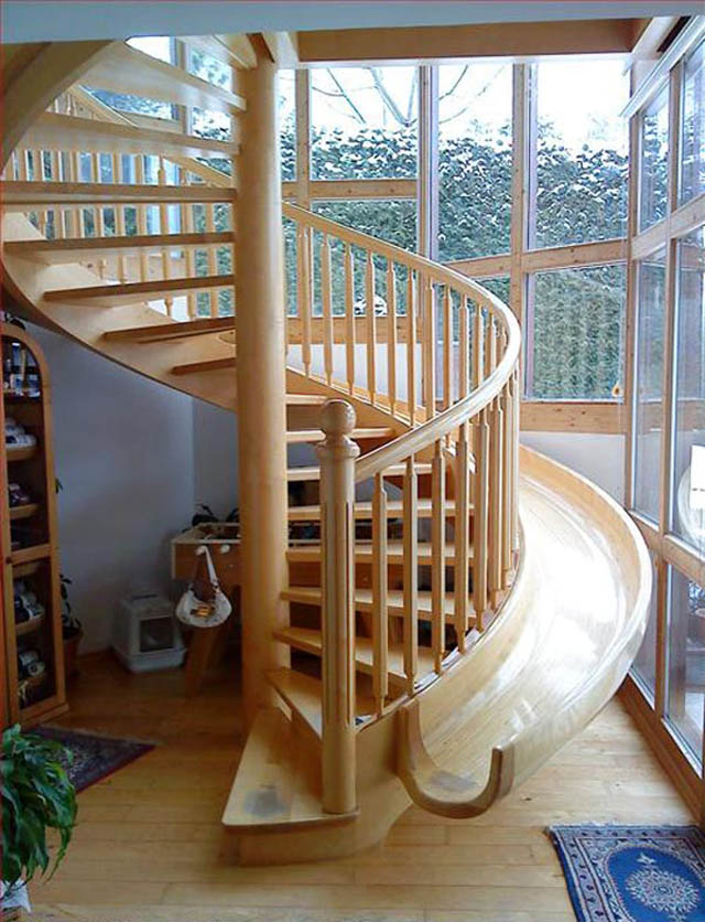 Captivating Beautiful Wooden Spiral Stairs With A Slide Integrated