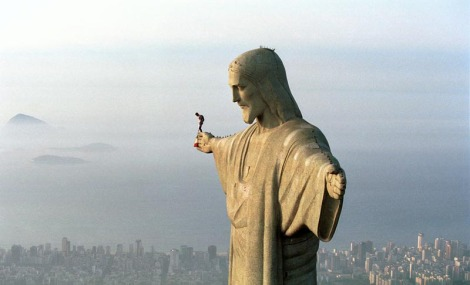felix baumgartner atop christ the redeemer statue in rio de janeiro brazil before be BASE jumps from the iconic statue