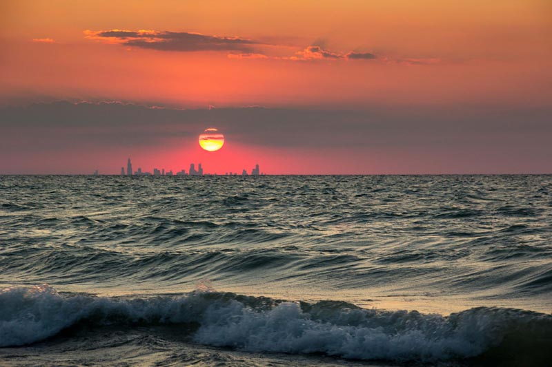 chicago skyline from indiana sunset across water The Top 75 Pictures of the Day for 2012