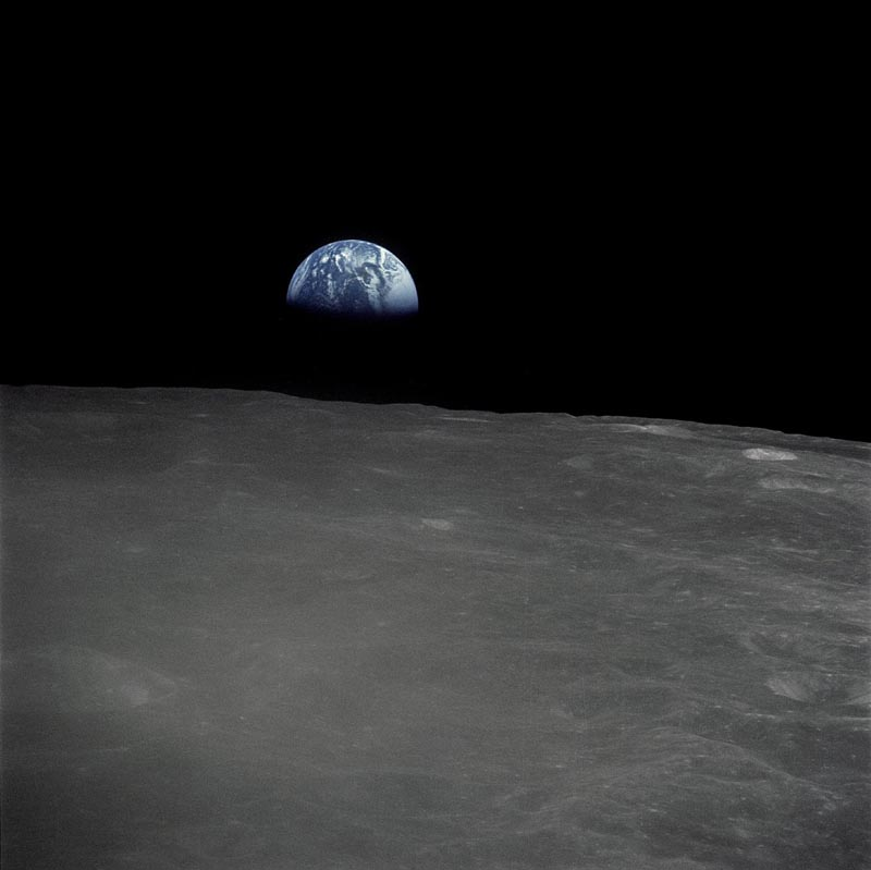 the earth rise as seen from the dark side of the moon