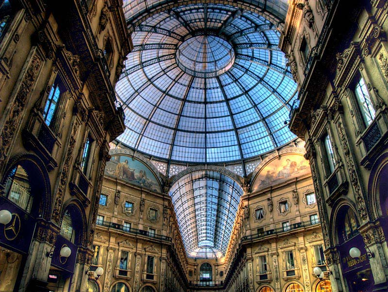 view looking up from the inside of the galleria in milan double arcade above