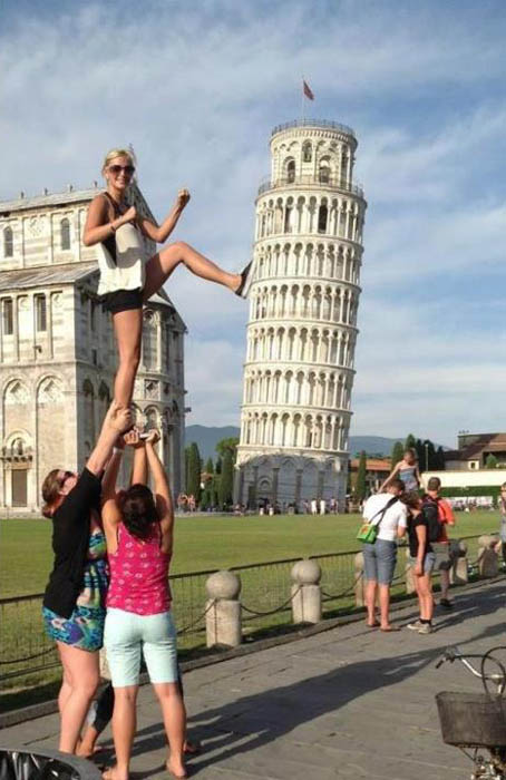 kicking the tower of pisa over and being held up by two friends to get higher