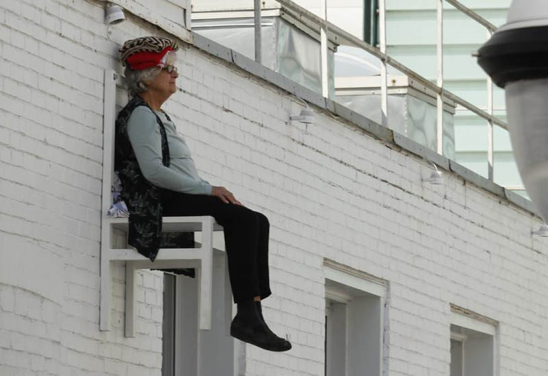 Elderly People Suspended High Above The Streets Of