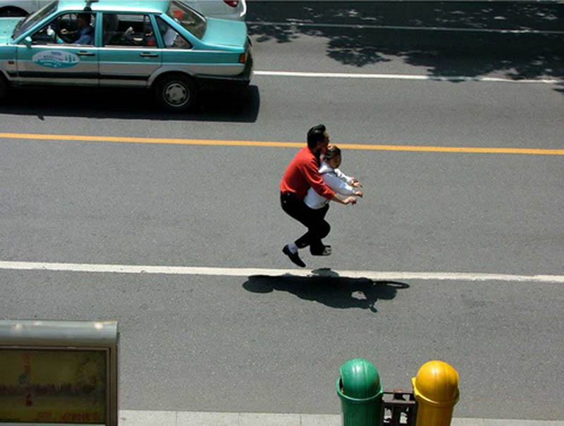 father and daughter riding an invisible bike on the road