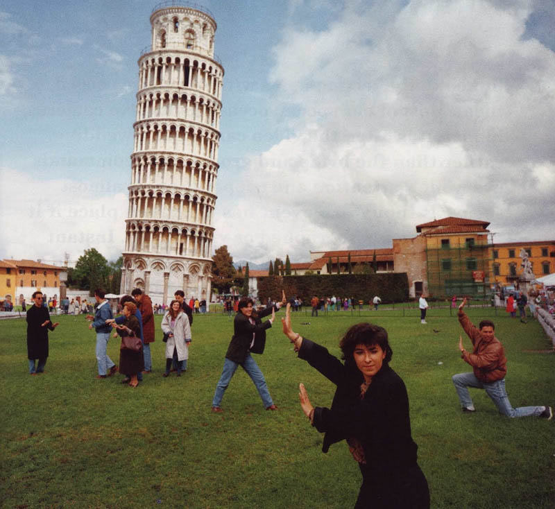 image of people pretending to lean on the tower of pisa in italy