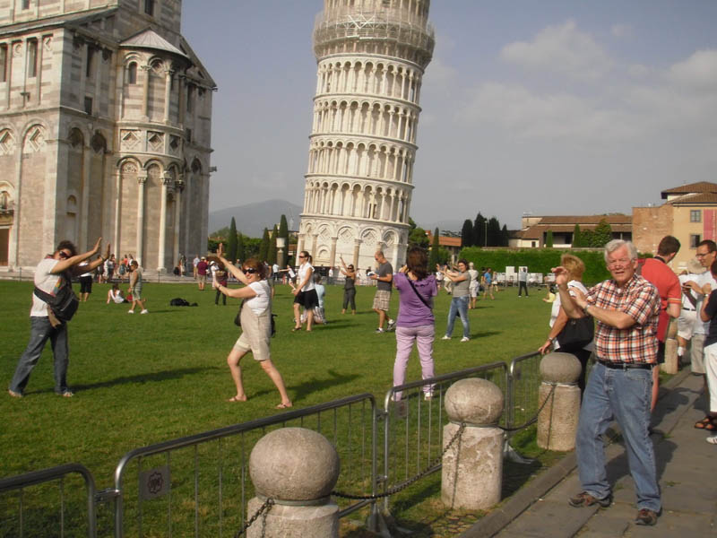 picture of various tourists all posing like they are leaning on the tower of pisa