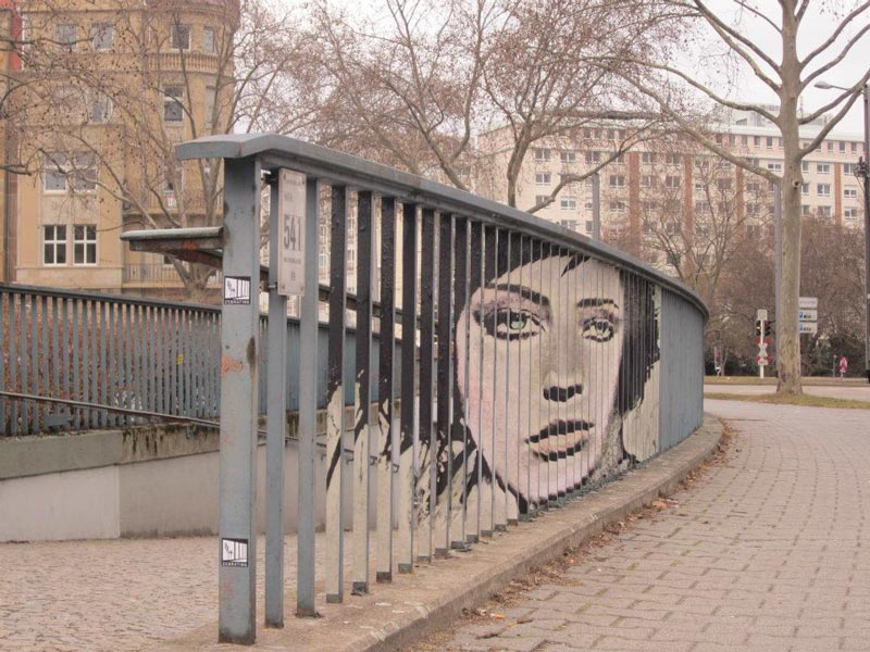 street art on railings by zebrating art 11 15 Street Art Portraits Chiseled Into Walls