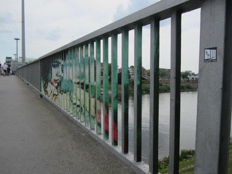 street art on railings by zebrating art 19 Amazing Street Art on Railings by Zebrating