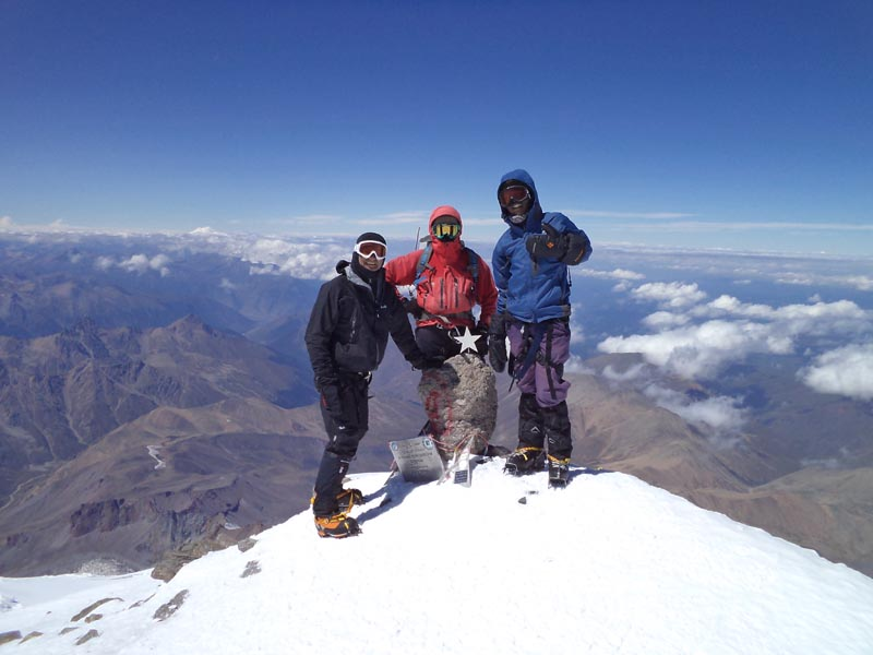 photo of three climbers at the summit of mount elbrus