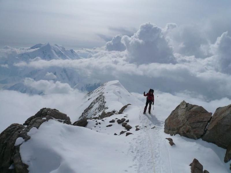 picture of a climber at the summit of vinson massif antarctica