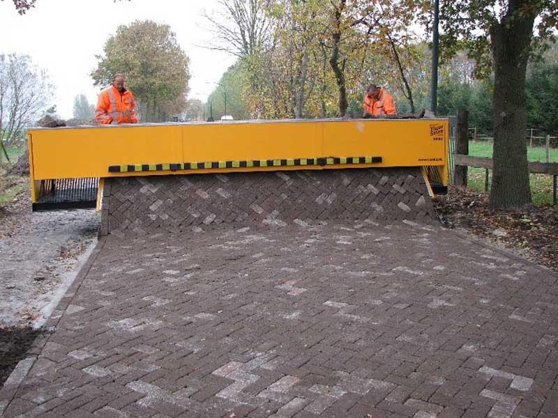 tiger stone interlocking brick road machine printer lays bricks 10 This Machine Prints Brick Roads