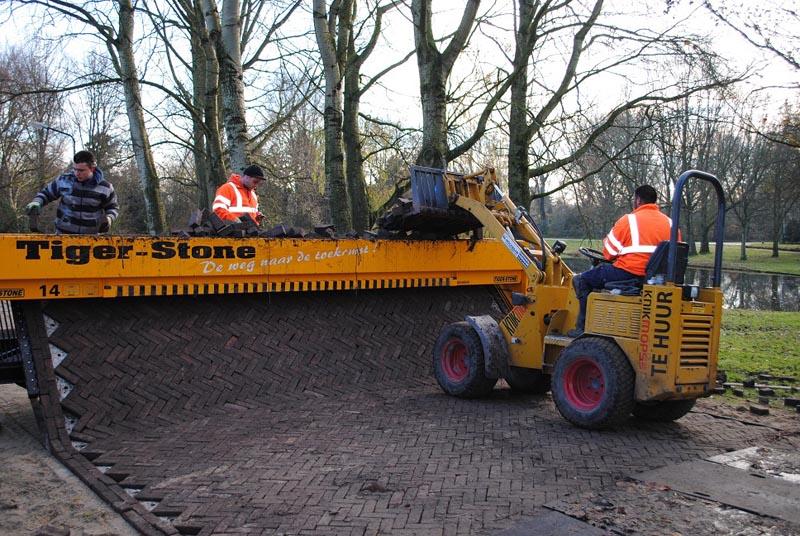 tiger stone interlocking brick road machine printer lays bricks 3 This Machine Prints Brick Roads