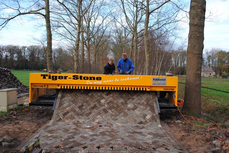 tiger stone interlocking brick road machine printer lays bricks 4 This Machine Prints Brick Roads