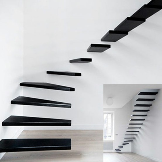 black floating stairs with no handrail