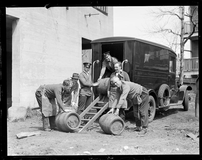 Police from Division 9 with casks seized during Prohibition posing for camera