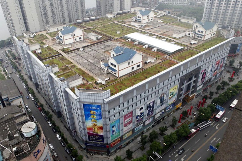 houses built on roof of shopping mall in zhuzhou china 1 Cramped Hong Kong Apartments from Above
