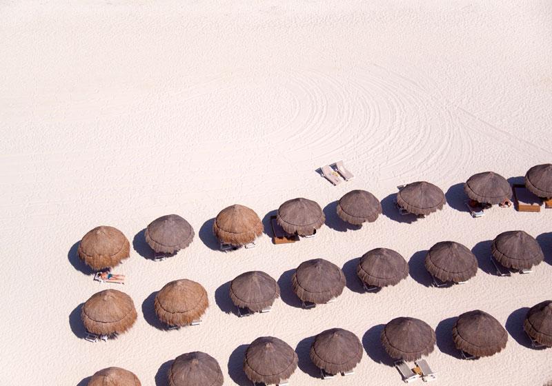 tiki umbrellas white sand aerial maison gray Beaches Around the World Seen from Above