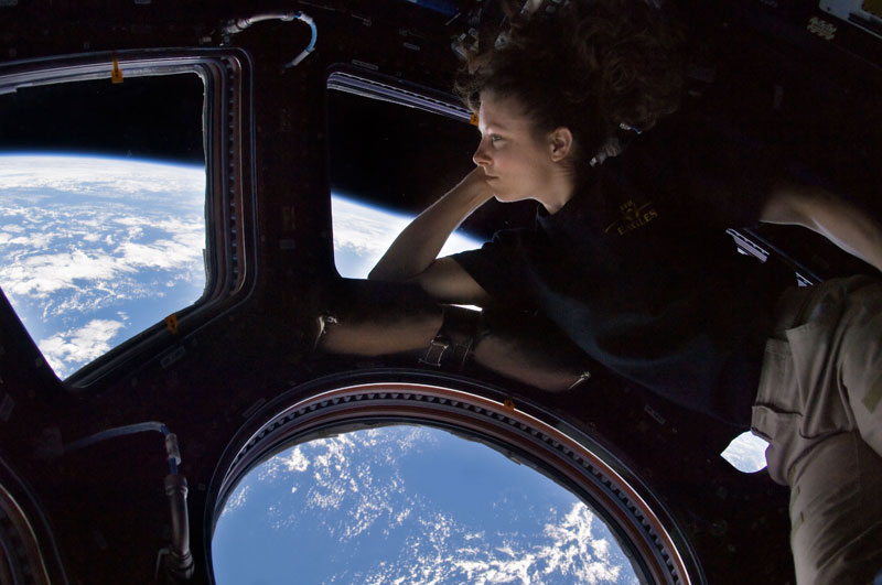 tracy caldwell dyson on board iss looking at earth The 2011 Wikimedia Commons Pictures of the Year