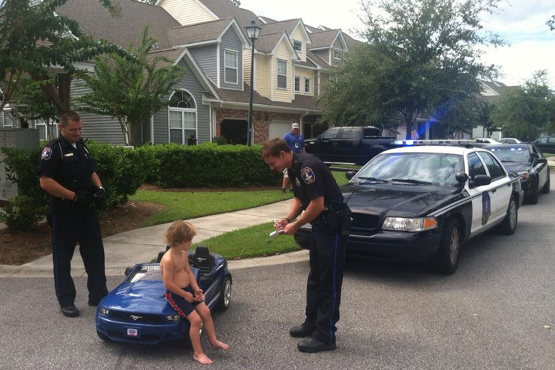 kid pulled over by cops in toy mustang The Shirk Report   Volume 180
