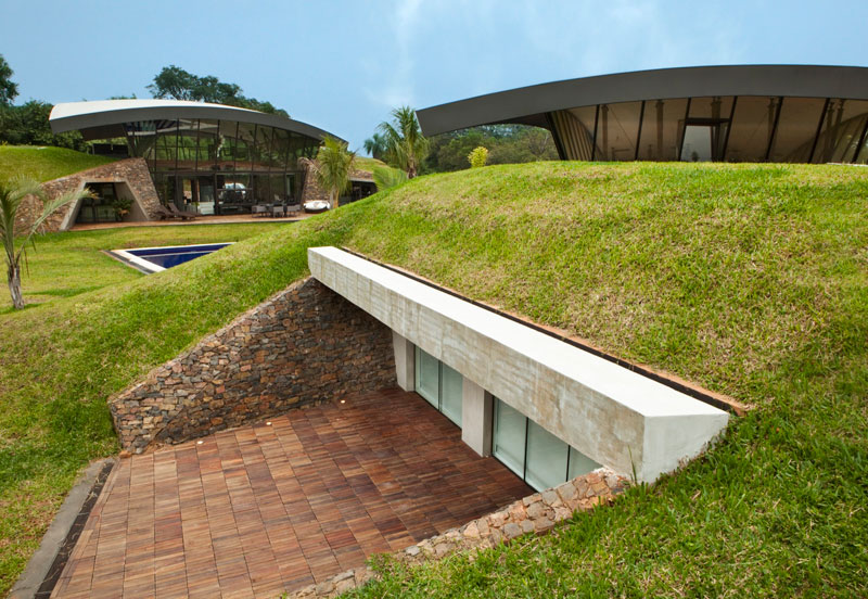 A unique hillside home built into the landscape twistedsifter for Modern underground home designs