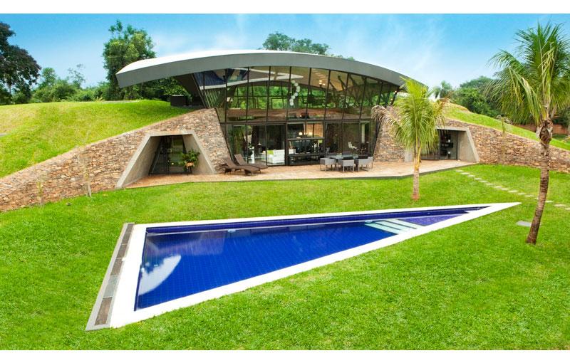 A unique hillside home built into the landscape twistedsifter for Pool design hillside