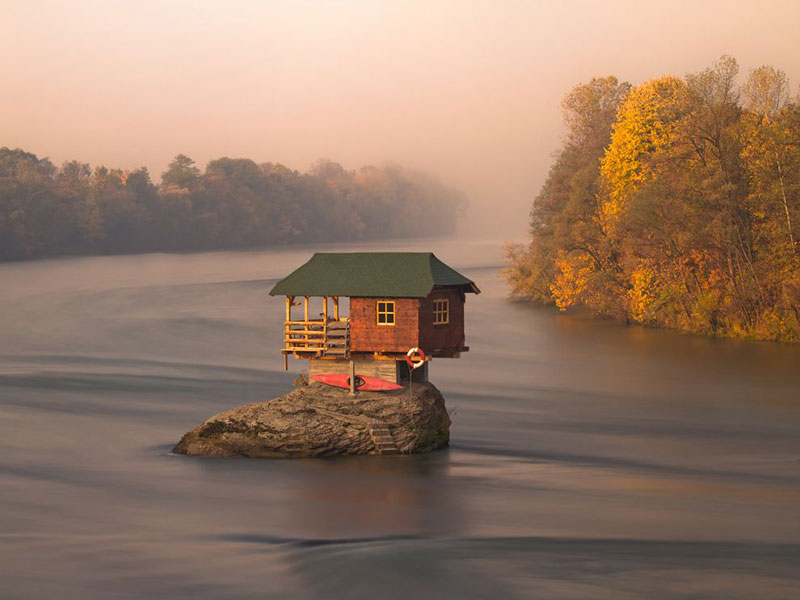 little house on rock in the middle of a river in serbia Picture of the Day: A Tiny River House in Serbia