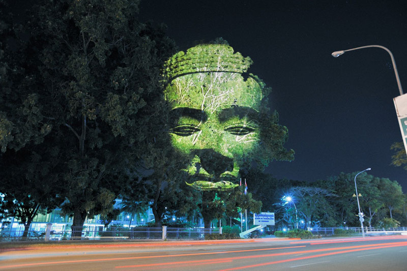 3d images projected onto trees clement briend 3 Faces Drawn Onto Maps by Ed Fairburn