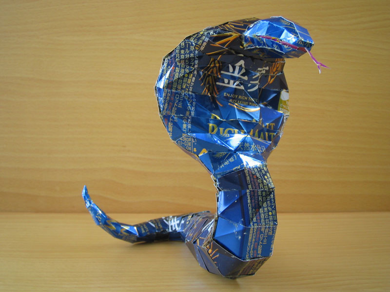cobra snake made from aluminum cans japanese artist makaon