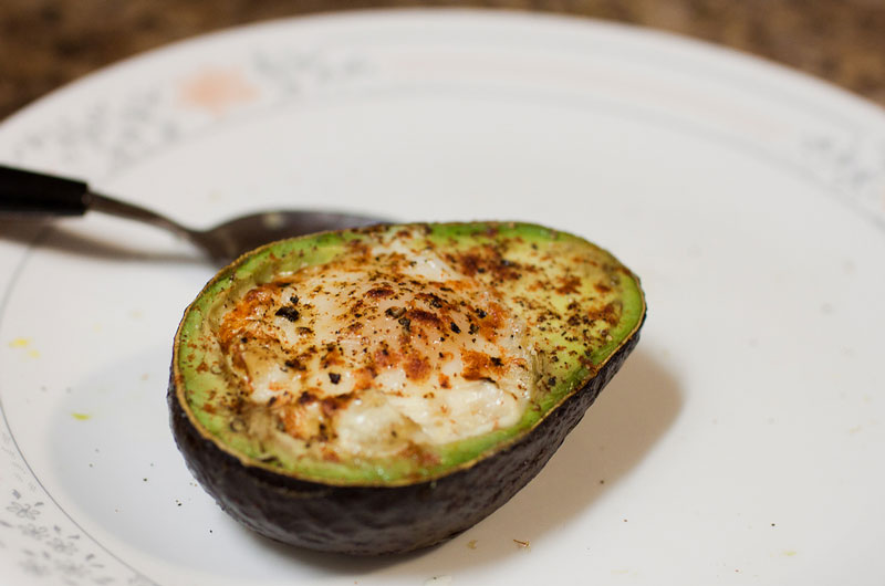 egg baked inside avocado 12 Delicious Dishes Served Inside Other Foods