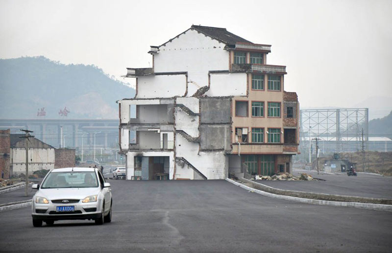 highway build around house in china 1 China Builds Highway Around House That Refuses to Move