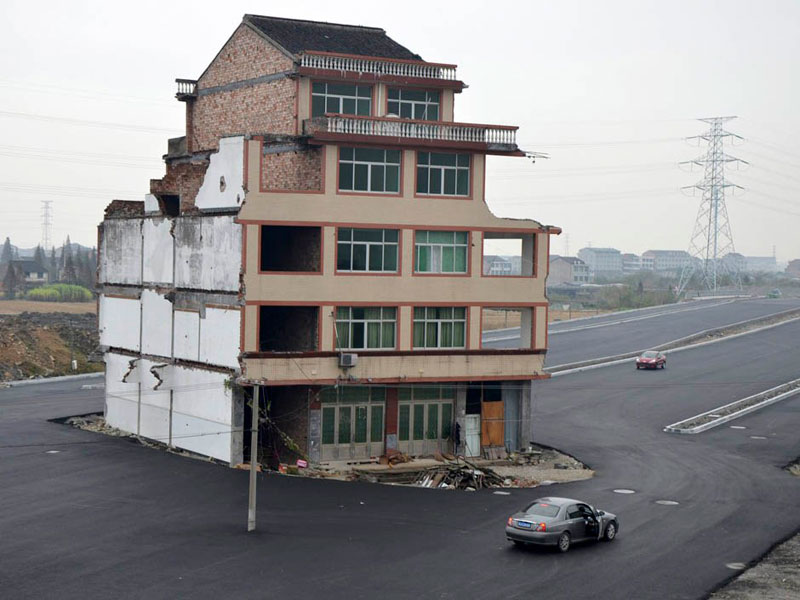 highway build around house in china 2 China Builds Highway Around House That Refuses to Move