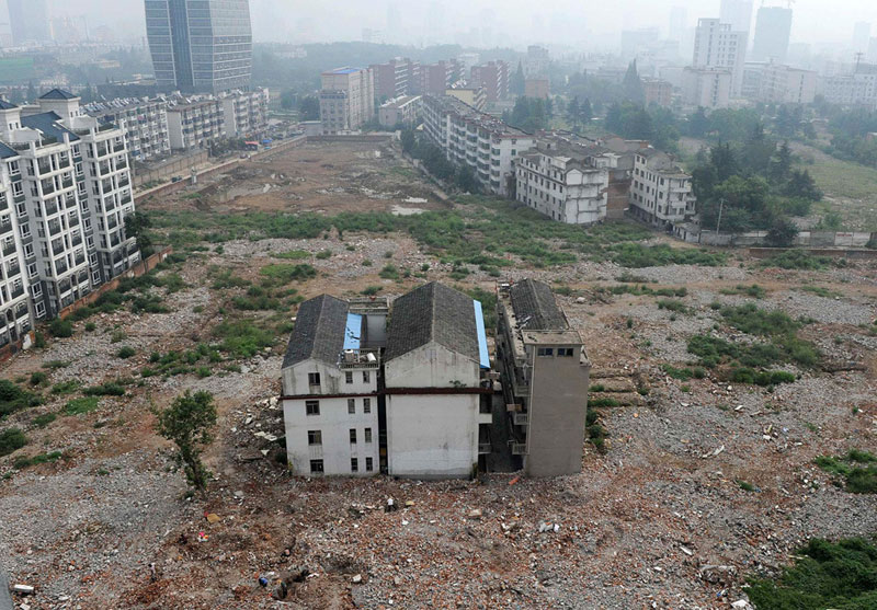 houses refuse to move sell nail house china 3 China Builds Highway Around House That Refuses to Move