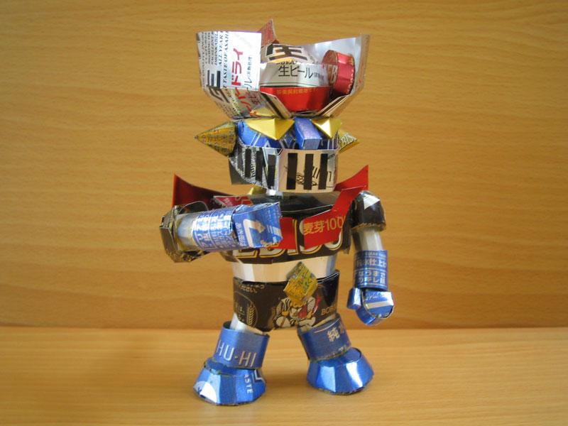 robot sculpture made from aluminum cans japanese artist makaon