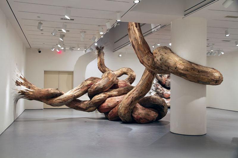 organic wood sculptures henrique oliveira 12 11 Sculptures Crafted from Old Skateboard Decks