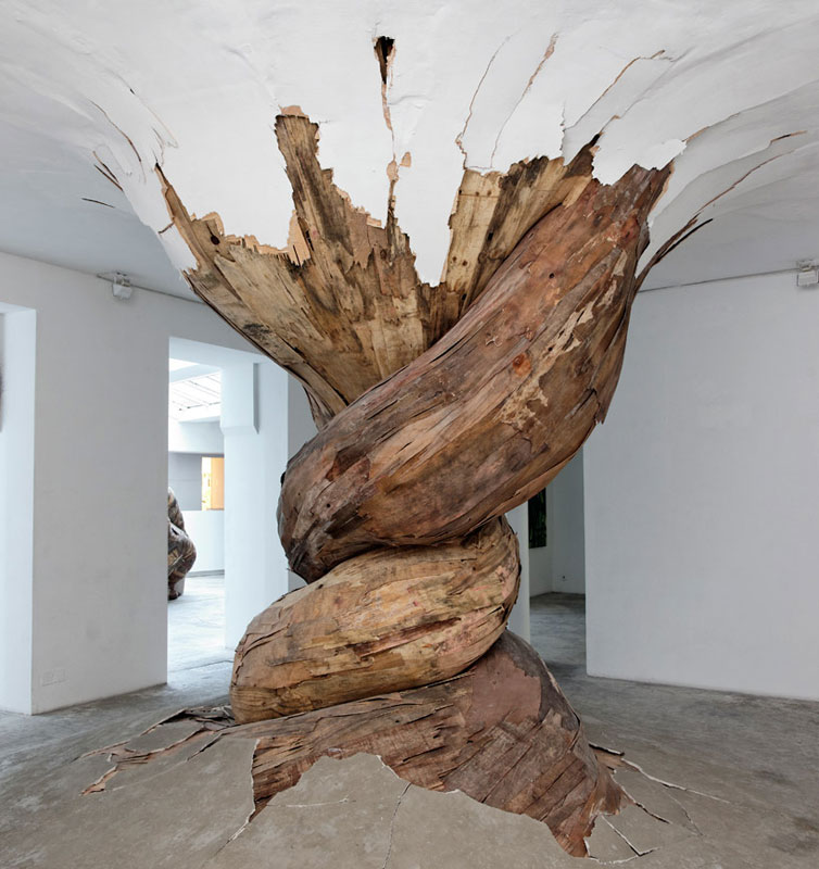 organic wood sculptures henrique oliveira photo aurelien mole A Giant Moon Carved Into Wood