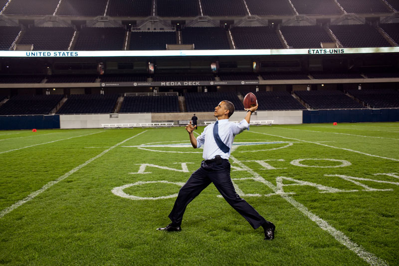 obama throwing football soldier field