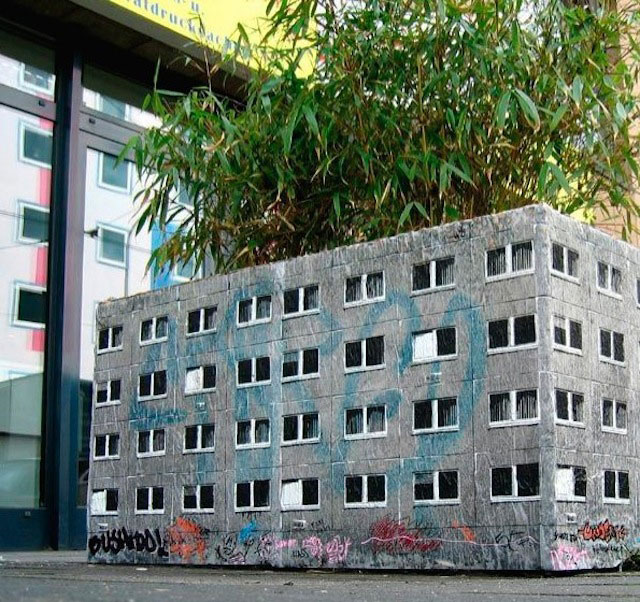 street art apartment building stencils by evol 1 Painter Turns Tree Holes into Works of Art