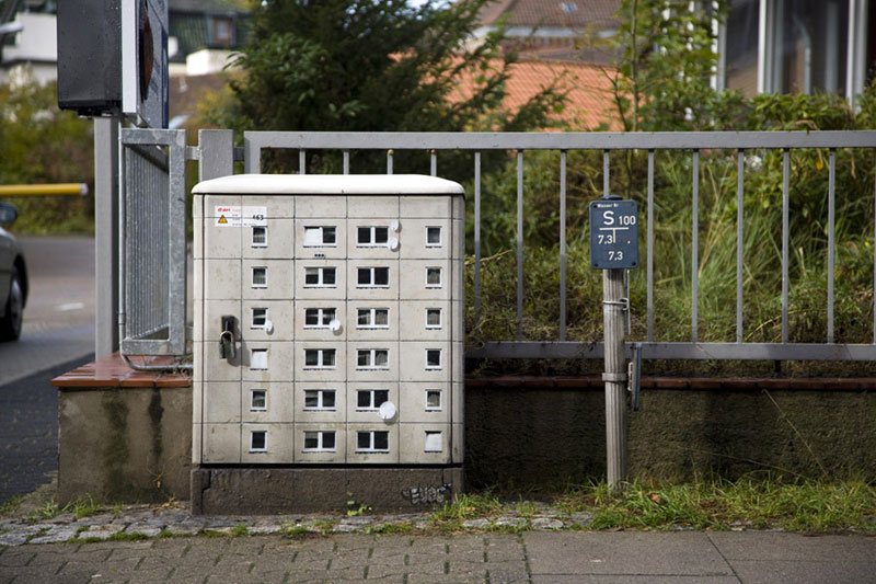 Artist Paints Miniature Apartment Buildings around the City