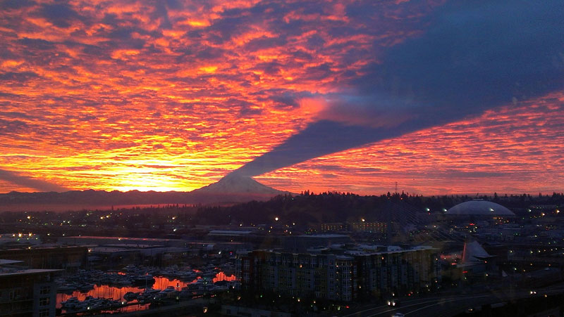 mt-rainier-casting-a-shadow-upward-to-clouds-sky-tacoma-washington