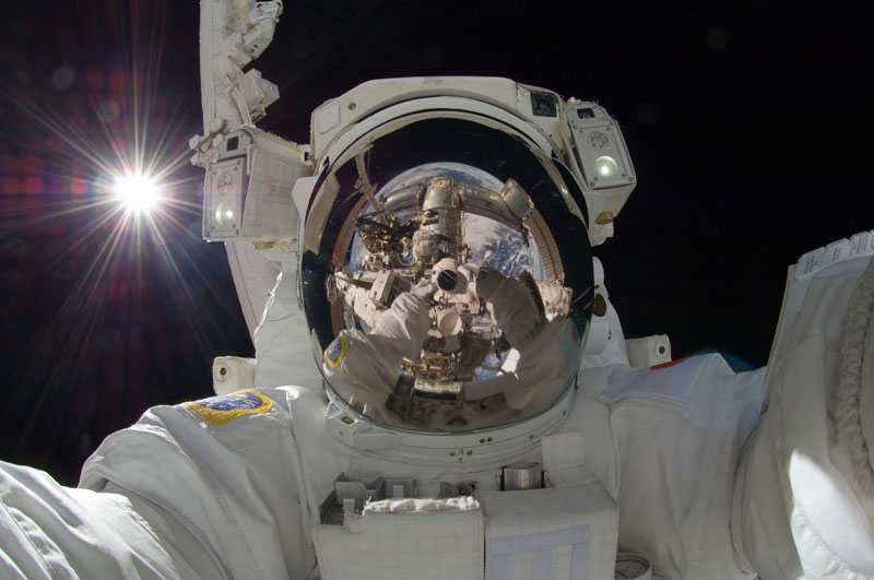 self portrait in space aki hoshide earth reflected in helmet Picture of the Day: The Space Selfie