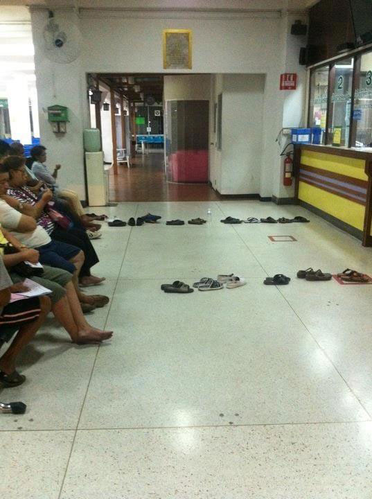 waiting in line in thailand shoes lined up people sitting The Shirk Report   Volume 201
