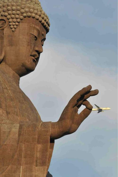 just a pinch buddah perfect timing The Ultimate Banksy Gallery (127 photos)