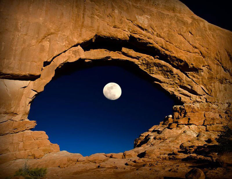 the moon through north window arches national park utah united states The 50 Most Perfectly Timed Photos Ever